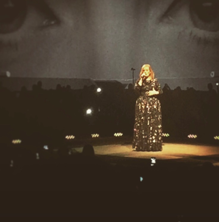"Adele singing ""Hello."""